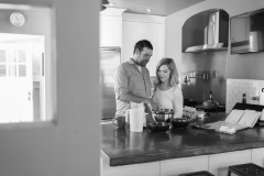 In-home couples portraits, black and white , cooking couples