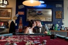 Kiss, kiss pool table wedding photography