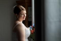 window light portrait , bride