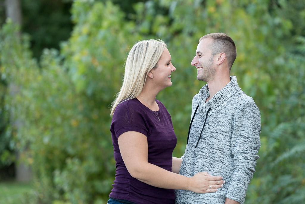 happy couple smiling engagement photo - muir image photography