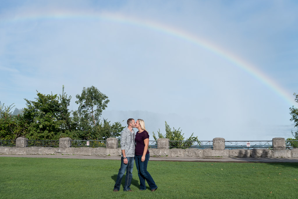 happy couple kissing engagement photo - muir image photography