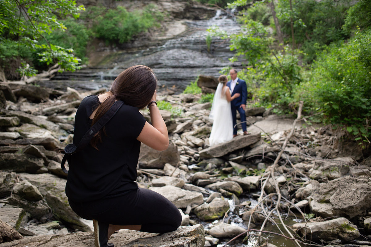 Muir Image Photography - Behind the scenes photo of Megan doing a wedding shoot outside.